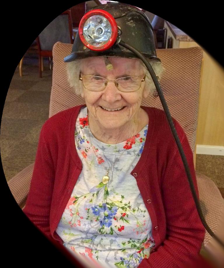 Creative Paths (elderly woman wearing old fashioned helmet)